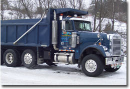 Heavy Equipment Hauling & Dump Truck services in VT & NH.